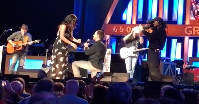A firefighter lit up one of country music's biggest stages in this sweet video