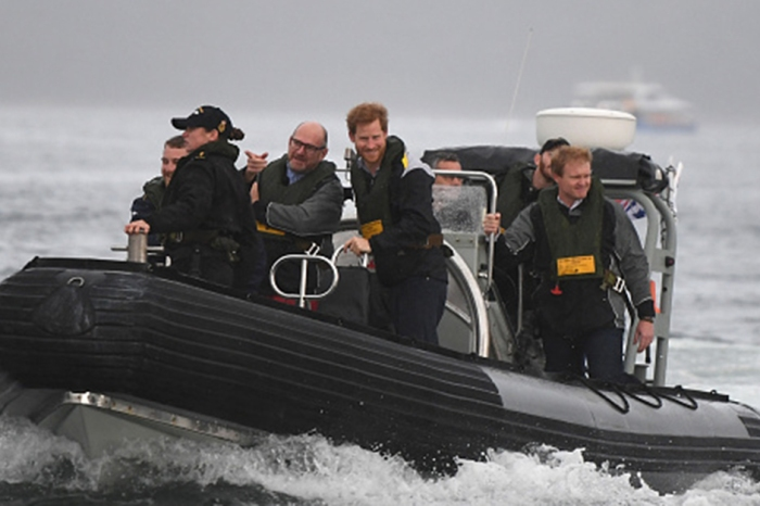 Prince Harry didn't let a little rain stop him from meeting his Australian fans for a good cause