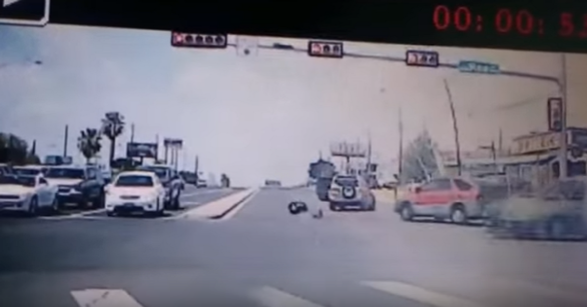 Dashcam video catches the horrifying moment a baby falls out of a moving car and onto the busy road