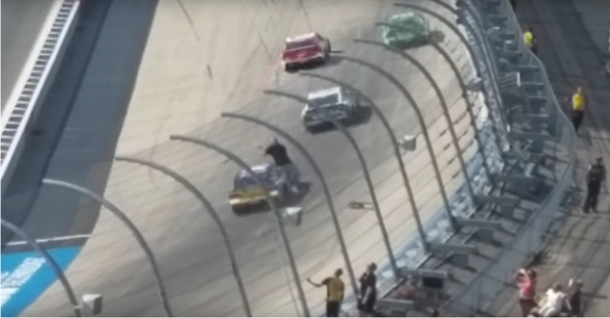 Crazy video shows fan scaling the Turn 4 fence during NASCAR race