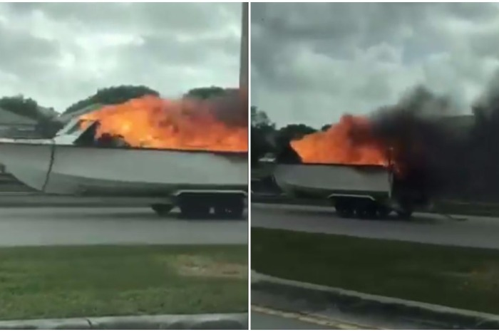 This guy drove down the road, apparently clueless that his boat was on fire