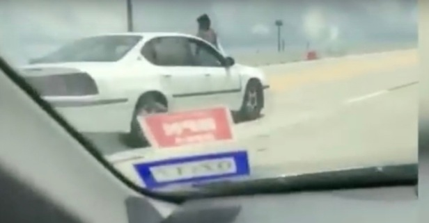 The Houston woman who rode on the hood of a car on Highway 290 has finally explained the video
