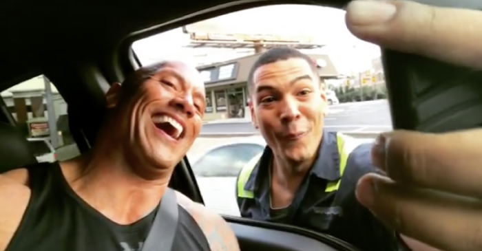 The Rock causes a traffic jam by stopping in the middle of the road to take a selfie with an excited fan