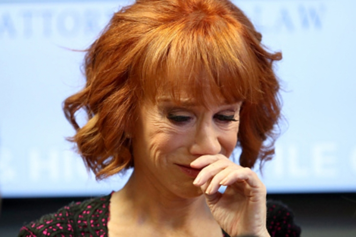 Kathy Griffin celebrates after John McCain casts the decisive vote to uphold Obamacare