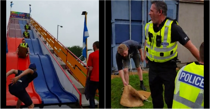 These wacky Scottish cops took a break from catching crooks to ride a very big slide
