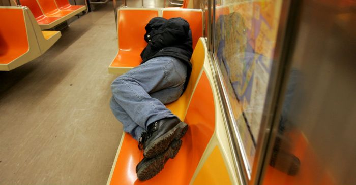 The last thing a sleepy subway rider expected was being awakened by someone else's bodily fluids