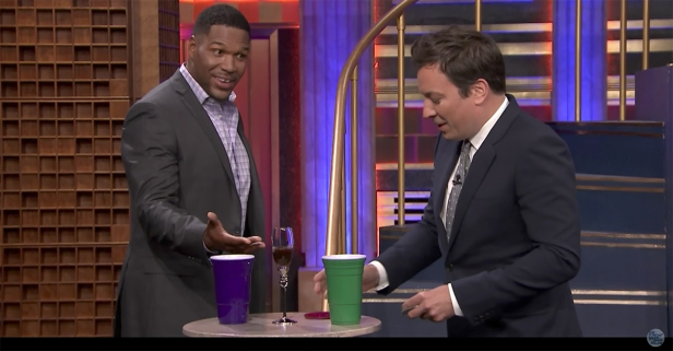 Jimmy Fallon and Michael Strahan chug gross cocktails together during a friendly game of 'Drinko'