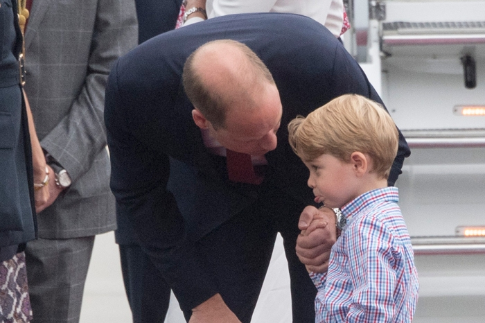 Prince George shows off a bashful side while on a royal tour of Poland