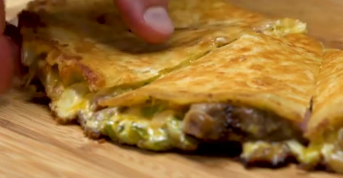 This cheesesteak quesadilla is the hot, gooey, extra cheesy snack of your dreams