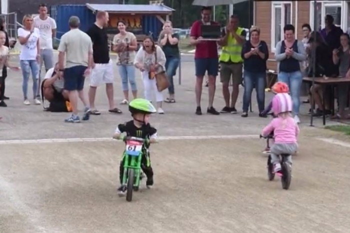 This boy is about to win the Dutch championship for walking bikes, but he decides to do this just inches from the finish line