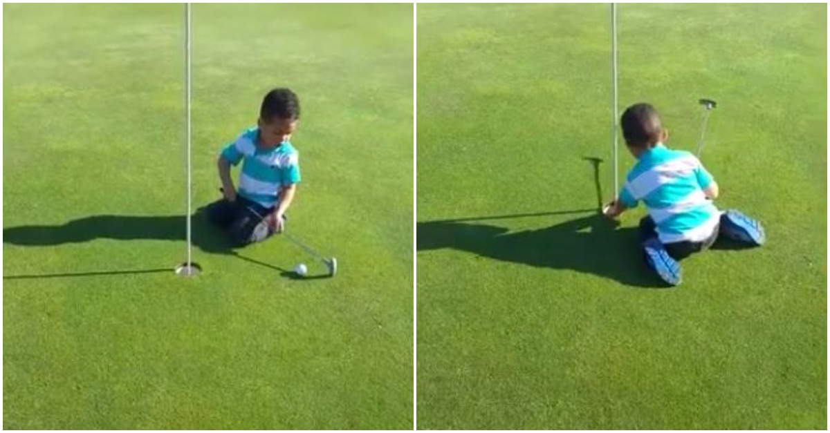Having difficulty hitting the ball with his mini golf club, this adorable kid makes up his own rule for the sport