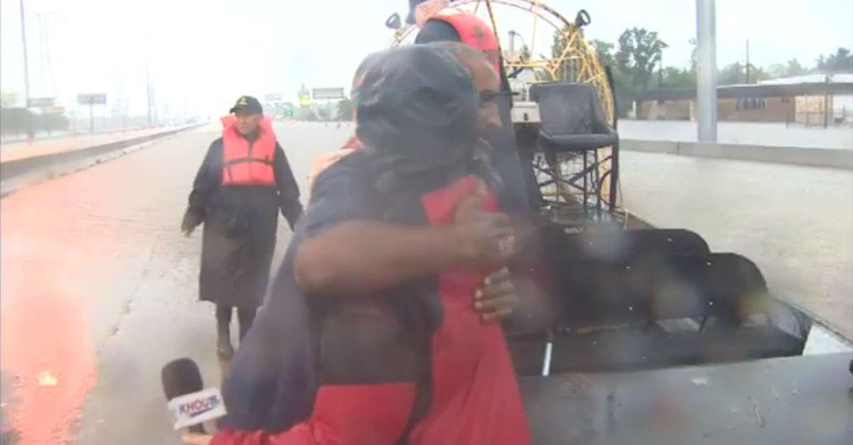 Television reporter saves truck driver after flagging down rescue boat while on air