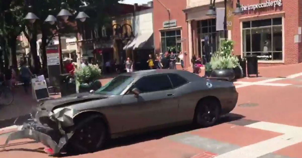 Chaos erupts in Charlottesville as a car plows into a crowd of protesters