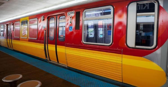 """Blue and brown CTA trains turning into """"Wienermobiles"""""""