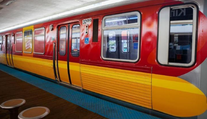 "Blue and brown CTA trains turning into ""Wienermobiles"""