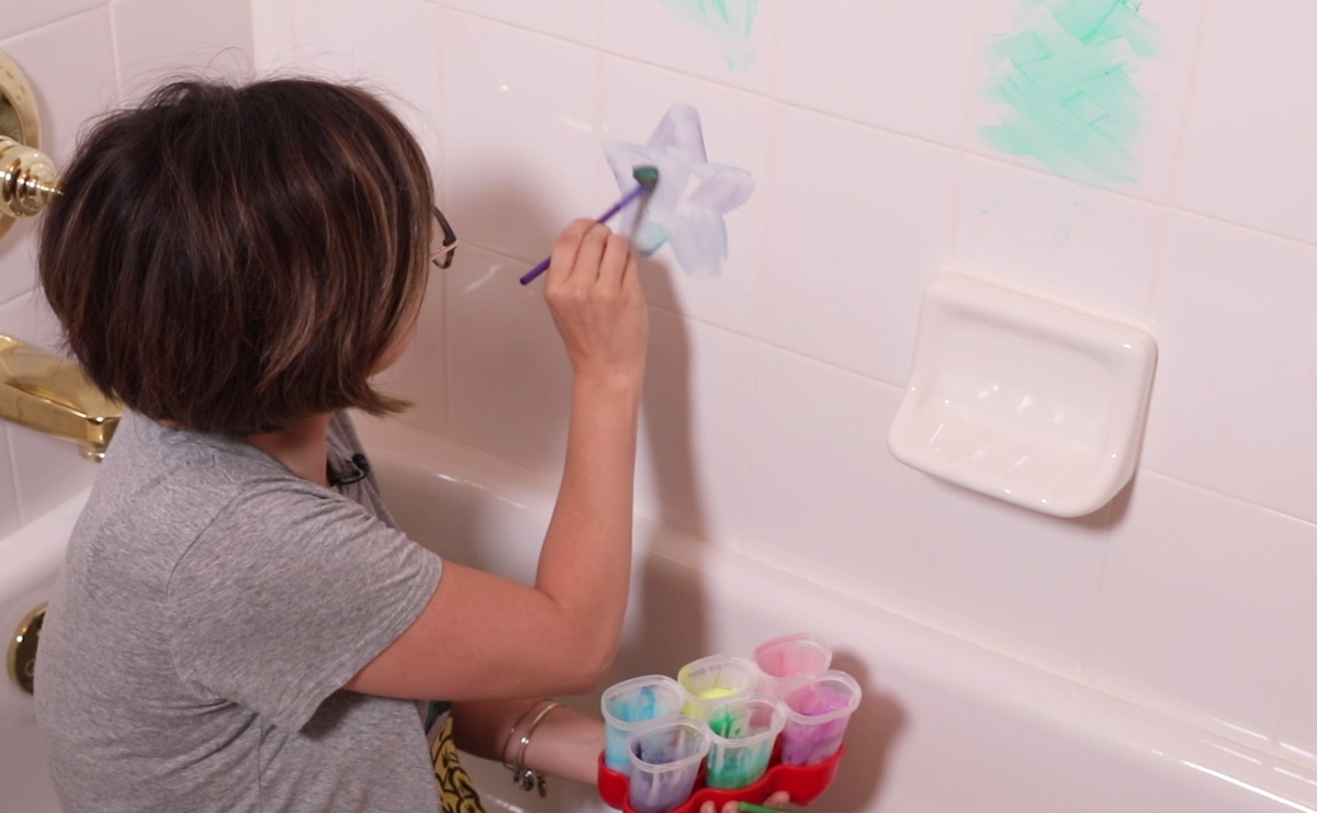 She mixes 3 ingredients to make these colorful bath paints that'll keep the kids entertained on a rainy day