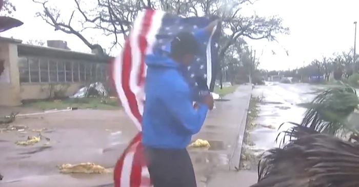 A reporter noticed an American flag in the hurricane debris and refused to leave it there