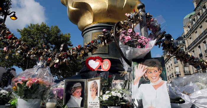 Mourners pay tribute to Princess Diana at the site of her fatal crash 20 years ago