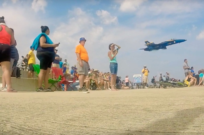 Watch the breathtaking moment a Blue Angel flew 100 feet over a crowd and knocked their socks off