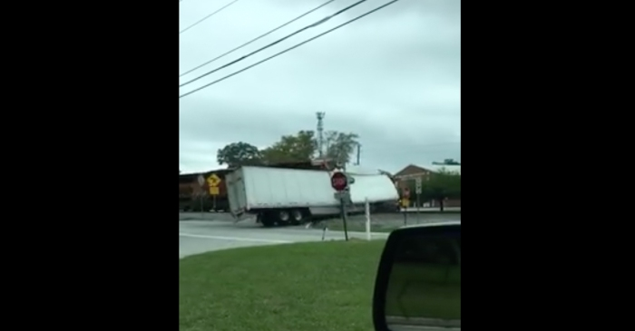 Cameras were rolling the moment a truck filled with candy was rammed by an incoming train
