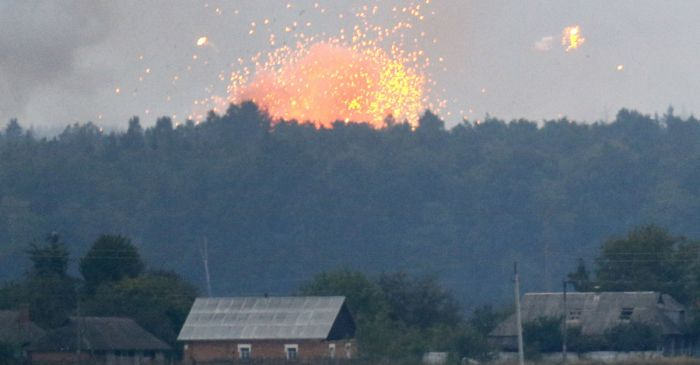 Spectacular ammunition depot explosion sends 30,000 people running