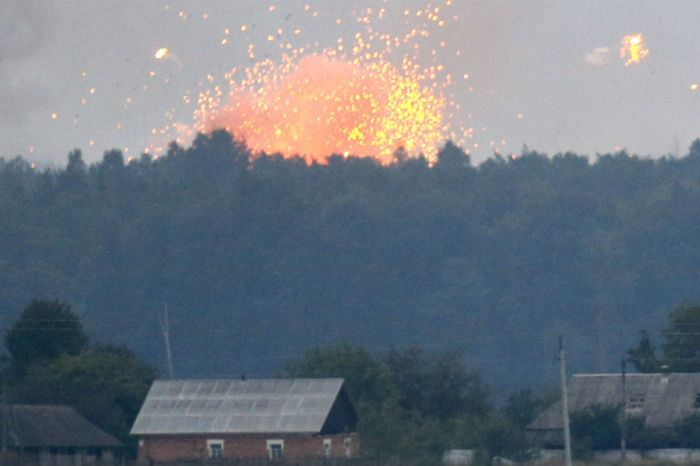 Spectacular ammunition depot explosion sends 30,000 people running