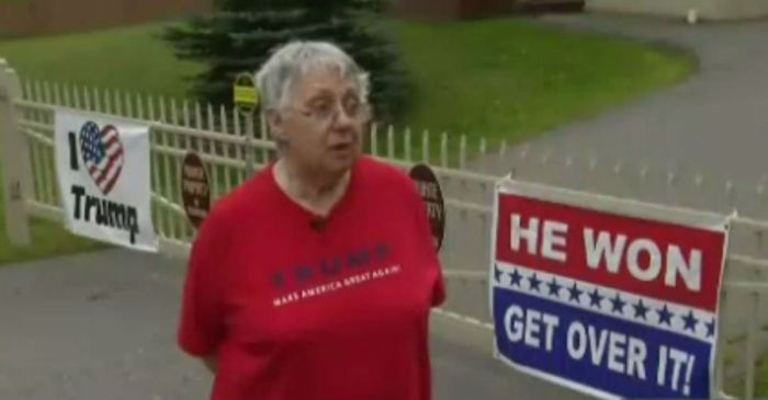 Faced with fines, Trump voter refuses to take down her massive signs