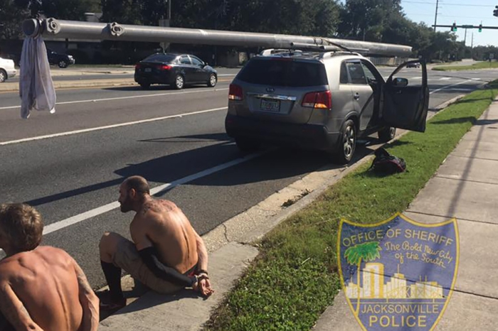 Police say post-Irma looters tried to strap a fallen power pole to their car