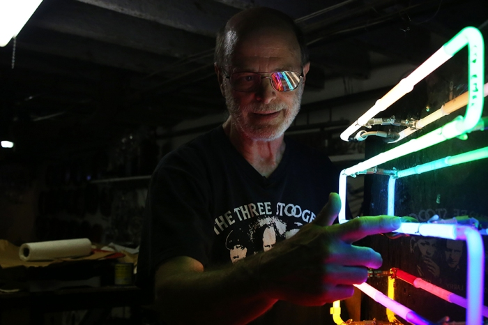 One bright idea: Restoring his city's past, one tube at a time