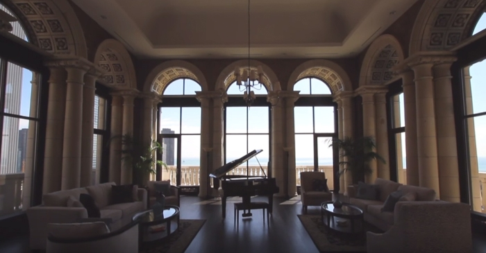 You can look inside (or buy) this ex-Bears's downtown palace