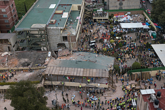 Rescuers race to find survivors in the rubble of a school collapsed by Mexico's earthquake