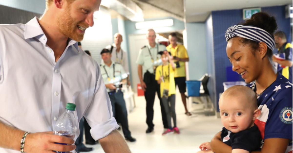 Prince Harry celebrates the USA's win at the Invictus Games with the most adorable fan
