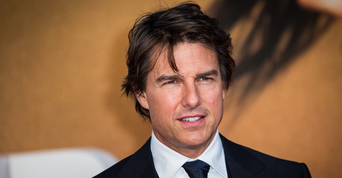 Families of two pilots killed on the set of a Tom Cruise movie partially blame the star