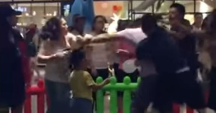 Two kids fought over a toy, so their parents decided to fight each other in a mall brawl