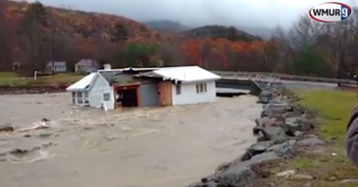 A house swept away by dangerous floodwaters meets a tragic end on video