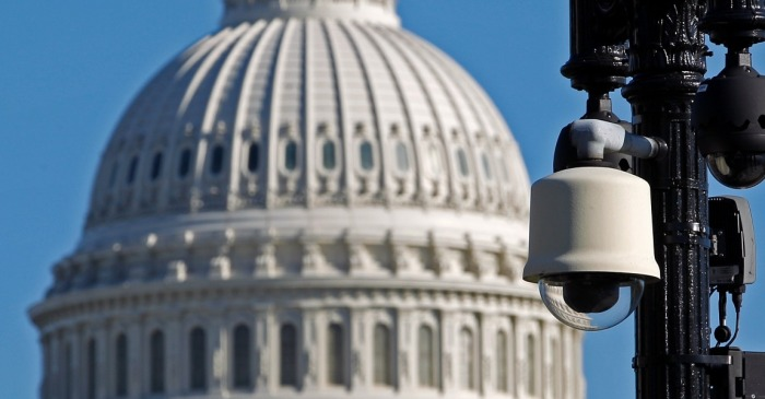 "Why did the White House and Congress give spy agencies a ""blank check"" in the stopgap spending bill?"
