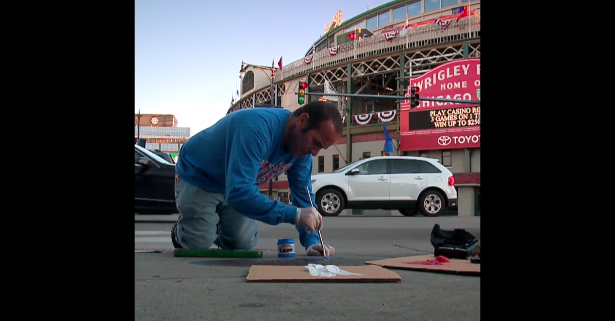 Two dedicated Cubs fans are taking their art to the streets, literally