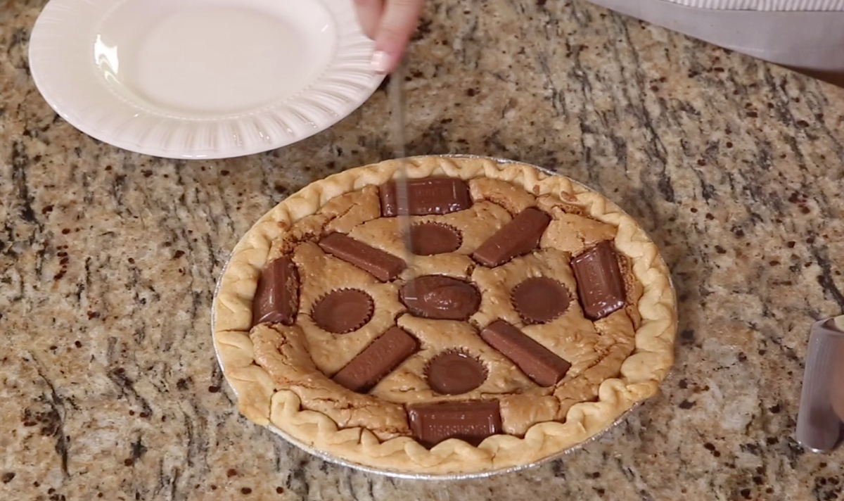 Dump all your Halloween leftovers in this super sweet and sticky candy pie