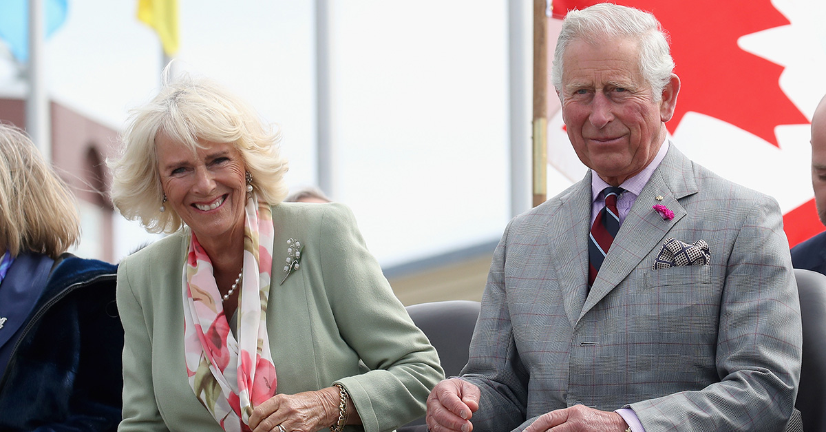 Prince Charles and Duchess Camilla were caught kissing in a rare PDA-filled appearance