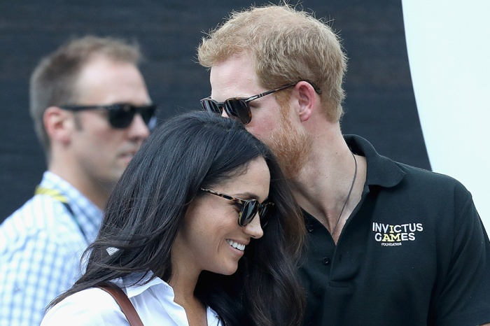 Prince Harry and Meghan Markle packed in the PDA as he wrapped up the Invictus Games