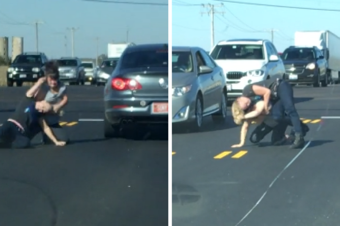 Three-car road rage incident erupts into an all-out street brawl at a busy intersection