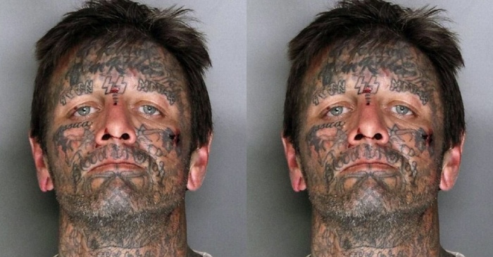 Man with a face full of Nazi tattoos tussled with cops over how he crossed the street