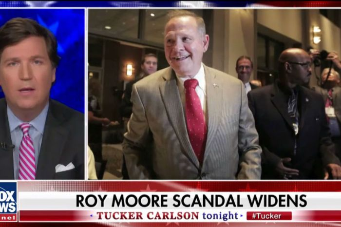Tucker Carlson rips Roy Moore's use of God with comparison to Al Sharpton