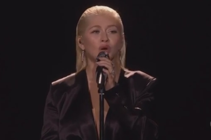 Christina Aguilera honored the great Whitney Houston at the AMAs, but fans are divided over the result