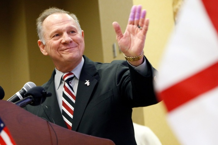 "Roy Moore's accuser's lawyer hits back after reports that his inscription in a high school yearbook was ""altered"""