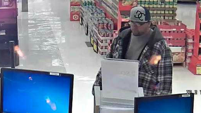 Bank robber hits TWO banks on Sunday in the Chicago suburbs