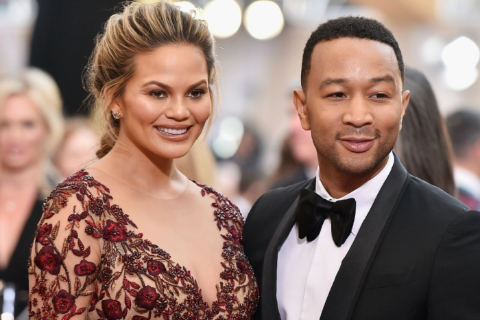 Chrissy Teigen just live-tweeted her awful flight, and we're glad we're not her
