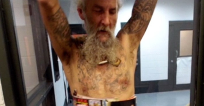 Alleged knife-fighter has a bizarre mugshot, but his raunchy armor has us chuckling