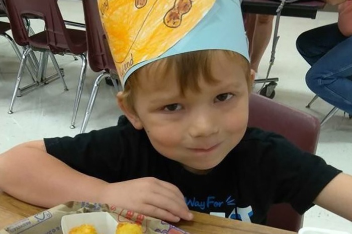 A 5-year-old Texas shooting victim clings to life, unaware of what happened to his family