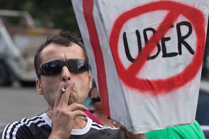 The massive anti-Uber taxi protests in Spain show the desperate need for deregulation